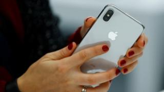 Photo of Apple blames China as it cuts forecast