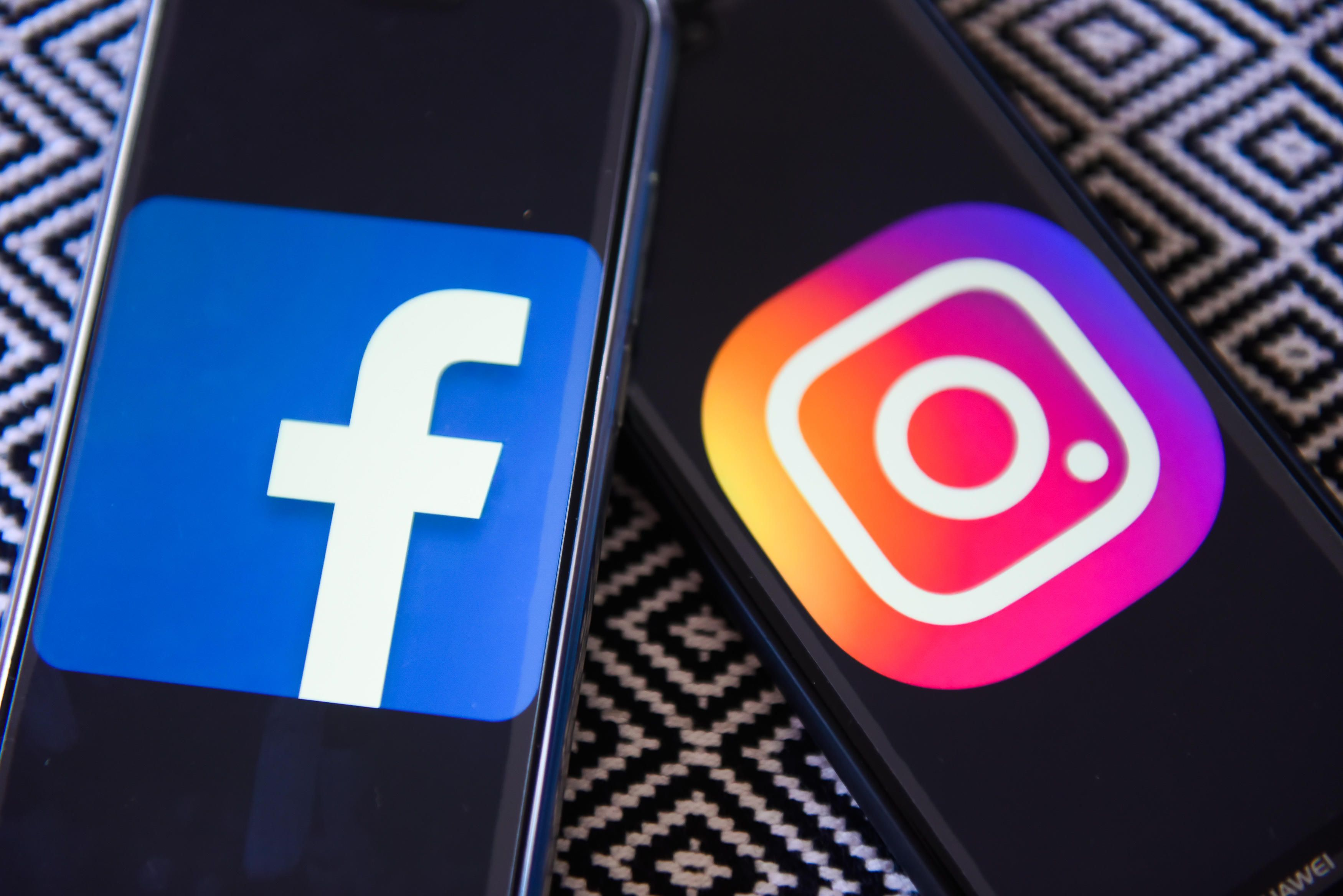 Facebook and Instagram logos are seen on a mobile phones