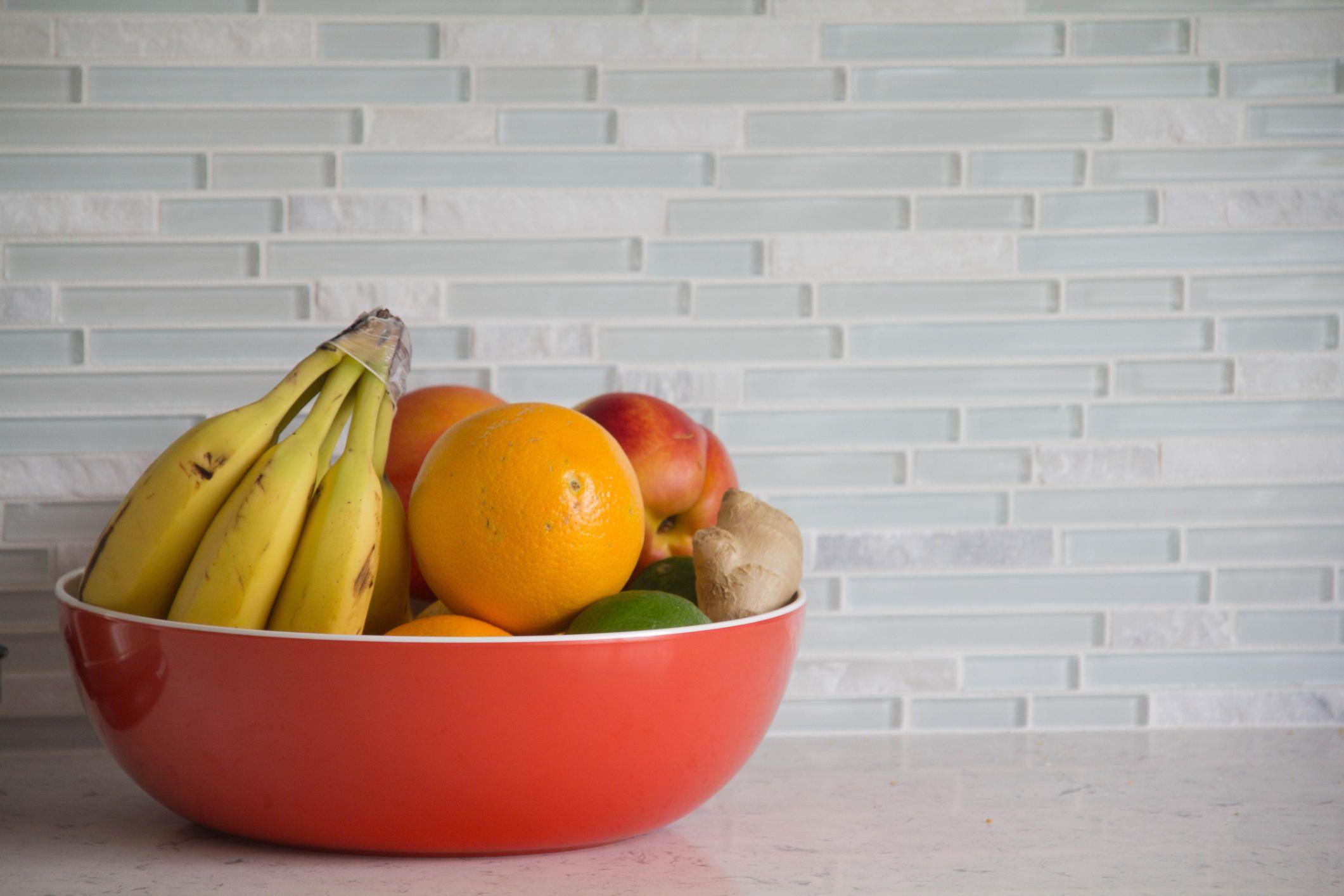 Fresh fruit in red bowl
